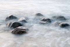 Rocky beach with clouds Royalty Free Stock Image