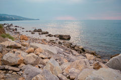Rocky beach on a cloudy day Royalty Free Stock Photography