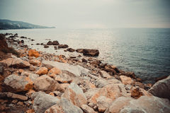 Rocky beach on a cloudy day Stock Photography