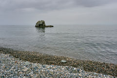 A rocky beach on the coast of the Aegean Sea Royalty Free Stock Photography