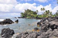Rocky beach coastline. Beautiful crystal clear water rocky beach coastline in hawaii Royalty Free Stock Photography