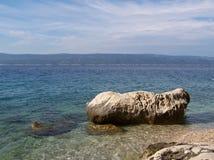 Rocky beach in Croatia. Wild croatian beach with rocks Stock Images