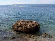 Rocky beach in Croatia. Wild croatian beach with rocks Royalty Free Stock Photo