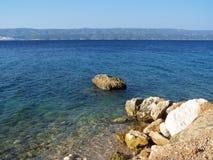Rocky beach in Croatia. Wild croatian beach with rocks Royalty Free Stock Image