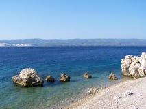 Rocky beach in Croatia. Wild croatian beach with rocks Royalty Free Stock Photos
