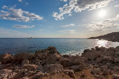 Rocky beach at day. Bay of Laspi. Crimea. Ukraine Royalty Free Stock Photos