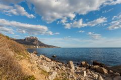 Rocky beach at day. Bay of Laspi. Crimea. Ukraine Stock Photos