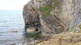 Rocky beach in Dorset near Durdle Door stock video footage