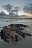 Rocky beach with dramatic sky Stock Photos