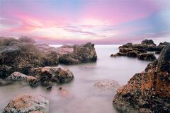 Rocky beach at dusk Royalty Free Stock Photo