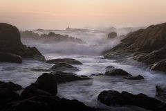 Rocky beach at dusk Stock Photography