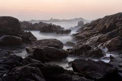 Rocky beach at dusk Stock Photos