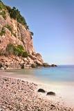 Rocky beach high cliffs blue sea stock photos