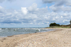 Rocky beach with high waves Royalty Free Stock Images