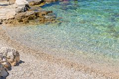 Rocky beach in Istria, Croatia. Rocky beach, bue transperent sea in Istria, Croatian coast stock images