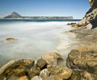 Rocky Beach in Javea. Beautiful rocky beach called Cala Sardinera, located in the Costa Blanca of Spain Royalty Free Stock Image