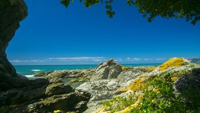 A rocky beach in Kaikoura, Canterbury, New Zealand. Kaikoura is famous for the many kind of wild life tourist attraction royalty free stock images