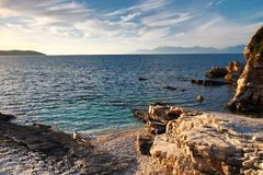 Rocky beach at Kassiopi in Corfu island, Greece.  stock photos