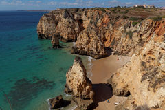 Rocky beach, Lagos, Portugal. Travel and business background Royalty Free Stock Image