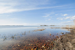 Rocky beach by lake. Rocky beach in Sweden with low water level, sunny day Stock Images