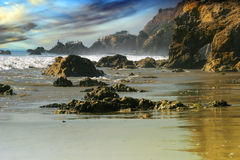 Rocky Beach landscape. Rocky coastline and beach with dramatic sky and color Royalty Free Stock Images