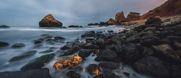 Rocky beach landscape at dusk. Odessa beach in the winter stock photography