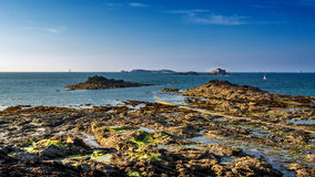 Rocky beach. Landscape photo: sunset at the coast of Dinard in Brittany France royalty free stock photos