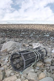 Rocky beach lobster pot Royalty Free Stock Photo