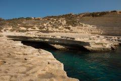 Rocky beach in Malta. Saint Peter`s pool. Rocky beach in Malta Stock Photo