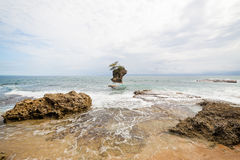 Rocky beach in Manzanillo Costa Rica. Beach and rock islet in Manzanillo Costa Rica Royalty Free Stock Photography