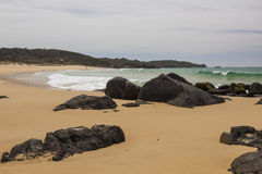 Rocky beach near Bingi point. Australia. Royalty Free Stock Photography