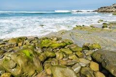 Rocky beach near cliffs in Spain Royalty Free Stock Photo