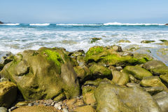 Rocky beach near cliffs in Spain Royalty Free Stock Images