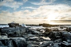Rocky Beach with Ocean Waves Stock Images