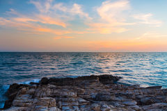 Rocky beach over the sea skyline and beautiful sky background Stock Images