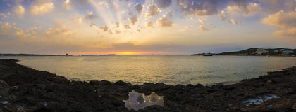 Rocky Beach Panorama at Sunset  in Ibiza island, Spain. Stock Image