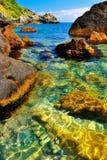 Rocky beach in a picturesque bay. Of a tropical island Stock Photos
