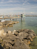 Rocky beach and pier at Veytaux on Geneva lake Royalty Free Stock Photo