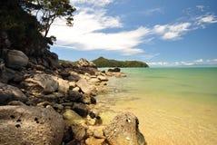 Rocky beach at pristine bay Royalty Free Stock Image