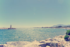 Rocky beach in Puerto Banus, Andalusia; retro/vintage Royalty Free Stock Images