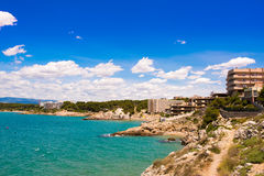 Rocky beach in Salou, Tarragona, Catalunya, Spain. Copy space for text. Royalty Free Stock Photo
