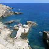 Rocky Beach of Santa Cesarea Terme, Puglia, Italy. People sunbuthing and swimming in Santa Cesarea Terme, Puglia, Italy Stock Photo