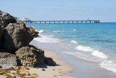 Rocky beach by sea Stock Photography