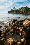 Rocky beach with sea water erosion Royalty Free Stock Images
