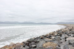Rocky beach seaside Ireland. With mountains in the background Stock Image