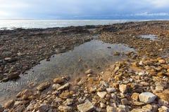 Rocky beach. sky withe clouds. Beach Rocks Blue Ocean Beach rocks ocean horizon blue water coastline landscape Stock Photography