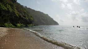 Rocky Beach slow motion. Pan shot of a beautiful beach on Bali, Indonesia stock video footage