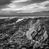Volcanic rock formations at St Monans in Fife. The rocky beach at St Monans in Fife, Scotland where volcanic rock formations protrude through the surface stock photography
