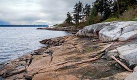 Rocky beach in the Strait of Georgia stock photos