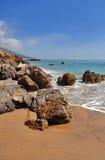 Rocky Beach in Sunny Malibu California. Rocky beach on a sunny day in Malibu California. Footprints in the Sand Stock Images